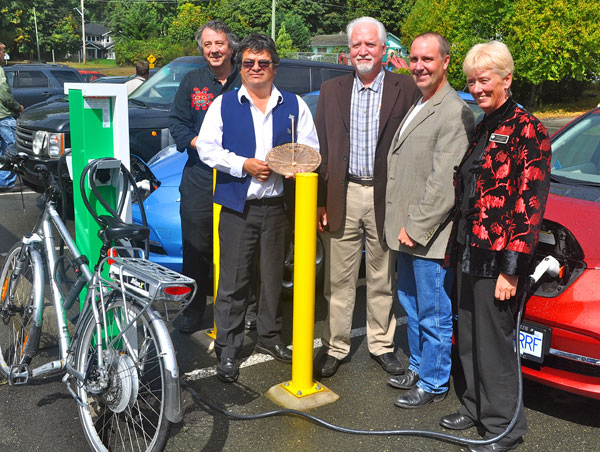 Surrounded by electric cars recharging are: Andrew Moore, Chief Planes with sundial, Bob Haugen of Solar City, MLA Mike Bernier and Colwood Mayor Carol Hamilton